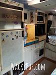 This is a not very good picture of My Kitchen where you can see how I raised to the sink and counters. I removed the little stove and replaced it...