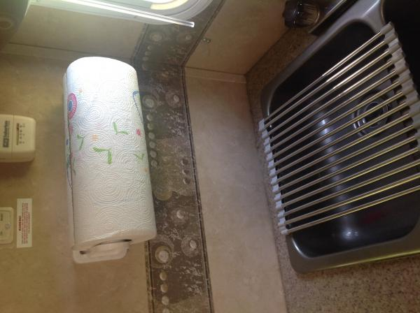 Paper towel holder and over sink drainer