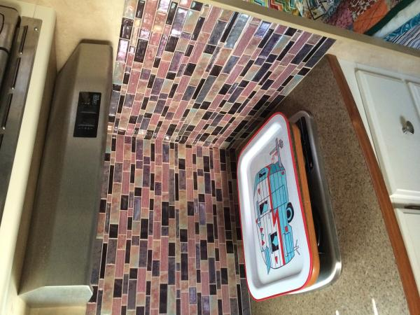 Wall with peel and stick tiles added and my new tray!  Sorry it's sideways!