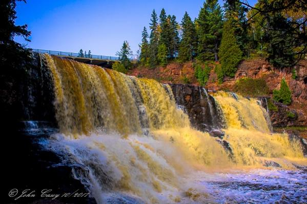 Gooseberry Falls running full and yellow after heavy rains, MN