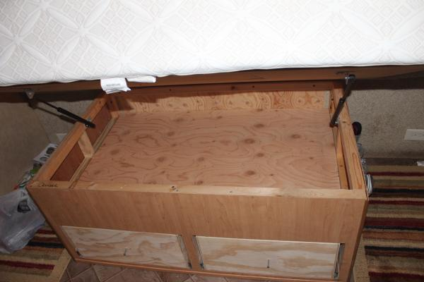 Above the drawers, another plywood piece so larger things can be stored.