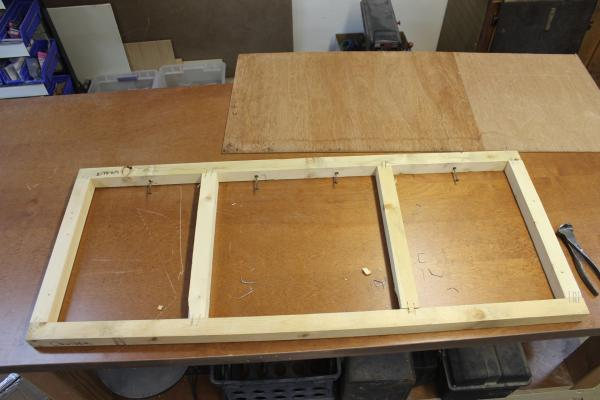 Other than cutting drawer holes in the front paneling, this is the only piece that had to be rebuilt.  It is the front frame under the foot of the bed.