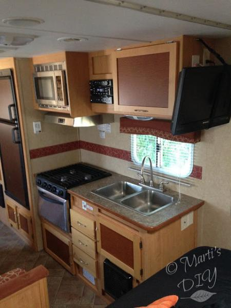 The trailer had had very little done to it in six years.   I attached a paper towel holder to the wall and command hooks beside the stove for coffee cups, but what to do about limited counter space? Not too bad when camping for a weekend, but when living in it full time, it became a problem.