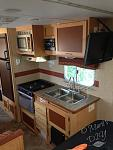 The trailer had had very little done to it in six years.    I attached a paper towel holder to the wall and command hooks beside the stove for coffee...
