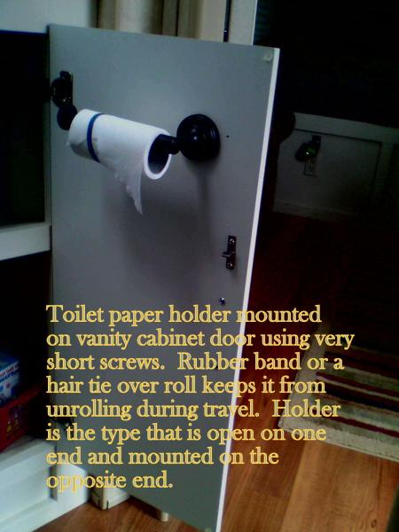 toilet paper holder I added to the vanity base cabinet door.  Easily reached while on the throne!
