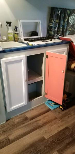 Inside cabinets...pop of coral