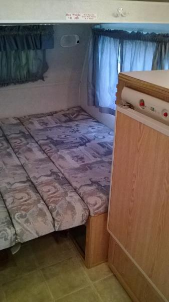 dinette bed with bunk down
