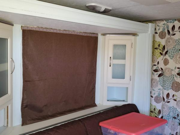 """Window Covering.  I removed the valance boxes and made """"Roman"""" Blinds.  They are Insulated and room darkening.  The best part is I bought room darkening curtains and cut them down to fit my windows.  That saved a lot of money."""