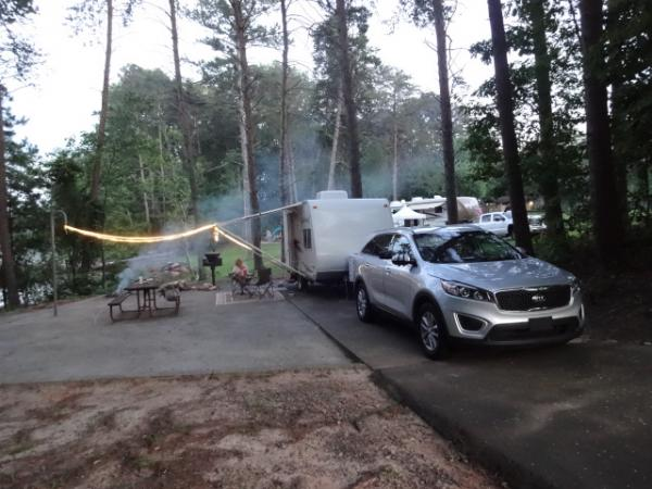 We pull our x160 with the Kia Sorento AWD, pulls nicely and still gets 18mpg.