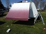 Score! Burgundy fade awning for the wee house on wheels. Found on eBay for $75. Easy install!